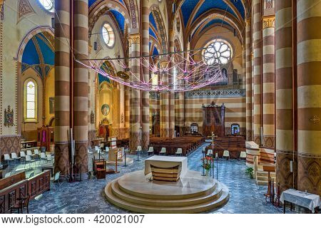 ALBA, iTALY - JUNE 12, 2020: Interior view of San Lorenzo Cathedral aka Duomo in Alba - small town in Piedmont, Italy, famous for its wine production and white truffles.