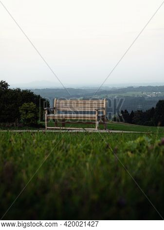 Panorama View Of Oversized Wooden Bench Seat Wanderbank Allgau In Oy Mittelberg Oberallgau, Bavaria