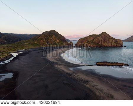 Aerial Nature Landscape Sunset Panorama Of Idyllic Remote Black Sand Beach Waitakere Ranges West Auc