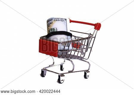 Bundle Of Dollars In A Shopping Cart Isolated On White Background