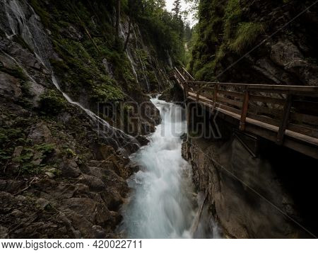 Nature Landscape Panorama Of Wooden Boardwalk Path In Raw Wild Mountain Stream River Gorge Ravine Wi