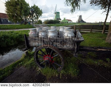Old Historic Vintage Traditional Wooden Milk Cart Wagon With Aluminium Steel Milk Cans In Zaanse Sch