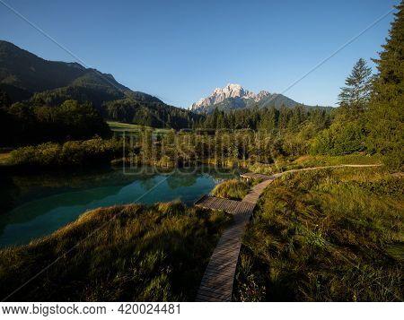 Green Nature Landscape Panorama At Idyllic Clear Blue Spring Zelenci River Lake Pond Near Kranjska G