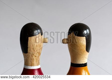 Narrow Countershot Of A Dialogue Between Two Wooden Puppets. The First Puppet, From Behind Next To T