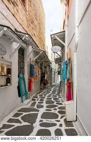 Paros, Greece - September 28, 2020: Greek Street With Whitewashed Pavement And Shops In Old Town Of