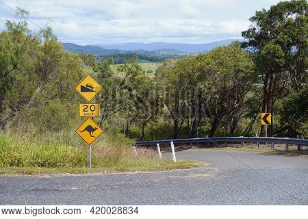 Road Sign Indicating Speed For A Steep Decline And To Beware Of Kangaroos