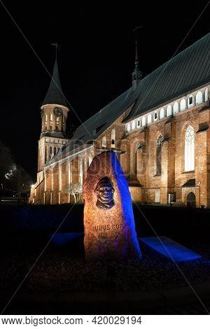 Memorial Sign To Julius Rupp At Night With Bright Illumination Against The Background Of The Konigsb