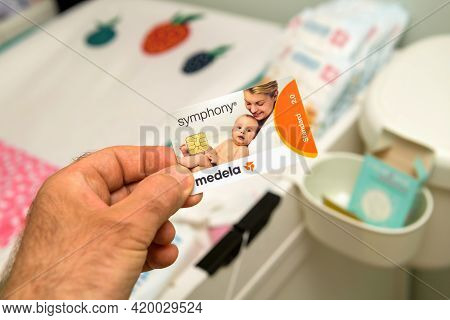 Paris, France - May 7 2021: Pov Male Hand Holding New Medela Made In Switzerland Pumps For Breastfee