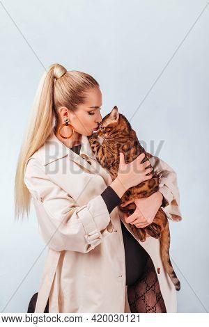 Cute Blonde Girl Posing In The Studio. Beautiful Blue Eyes. Girl With Bengal Cat. Beauty, Beauty, Fa