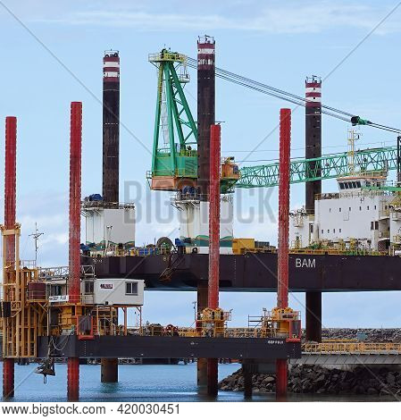 Mackay, Queensland, Australia - May 2021: Close Up Of Two Pile Driving Platforms On The Beach At Hay