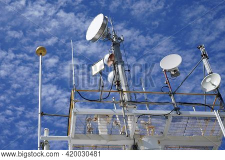 Mackay, Queensland, Australia - May 2021: Communications Technology Equipment On Roof Top Against A