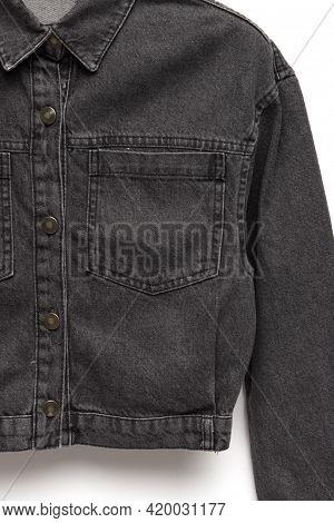 Black Denim Jacket For Background. Close Up Of The Front Of A Denim Jacket. Close-up Denim Jacket Po