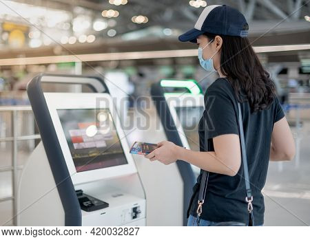 Female Hand Using The Auto Self Service Check-in For Get The Boarding Pass At The Airport.