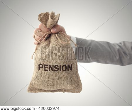 Pension money bag with  business man holding up outstretched