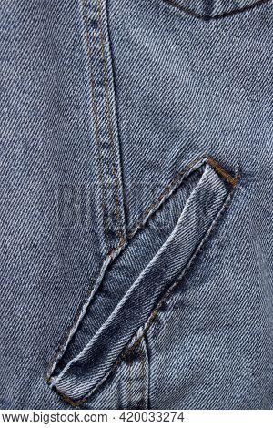 Close-up Denim Jacket Pocket. Denim Jacket Background. Blue Jeans Texture For Background. Close-up B