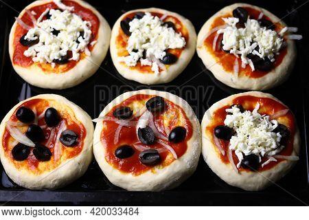 Cooking Mini Pizza. Mini Pizzas On A Baking Sheet.