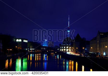 Night View Of Berlin City And River Spree . Capital City Of Germany During The Nighttime