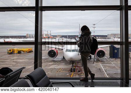 Girl Tourist With Backpack Waiting For Flight In Airport, Horizontal, Russia Moscow Vnukovo 2021-02-