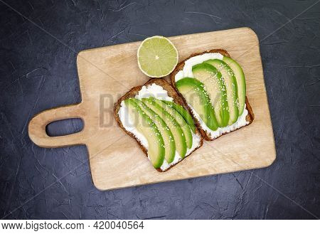 Sliced Avocado On Toasted Bread For Healthy Breakfast Or Snack. Sandwich With Avocado And Cottage Ch