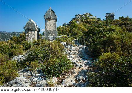 Lycian rock tombs, Rock sarcophagus at ancient Lycian necropolis on hill in Simena (Kalekoy), Turkey