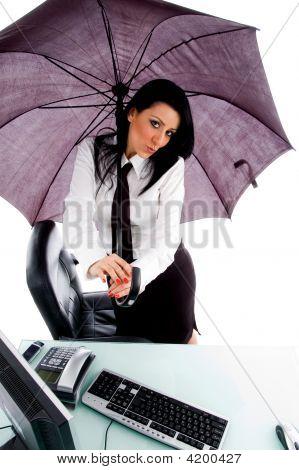 Female Holding Umbrella And Posing