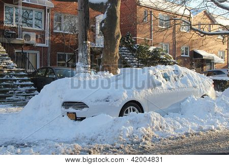 Car under snow in Brooklyn, NY after massive snowstorm