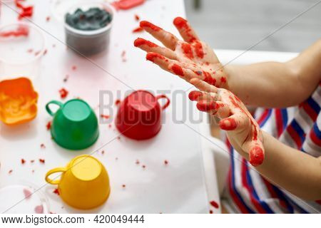 The Child Smeared His Hands In Kinetic Sand. An Educational Game Of Kinetic Sand With The Use Of Bri