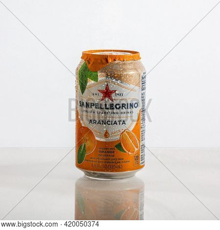 Sanpellegrino italian sparkling drink aluminum can on white background with reflections