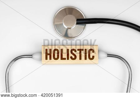 Health And Medicine Concept. On The Table Is A Stethoscope And A Wooden Plate With The Inscription -