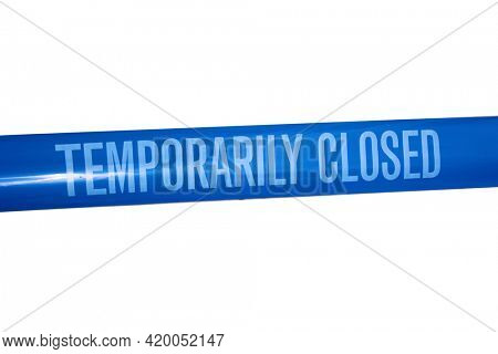 Temporarily closed caution tape. Closed due to Covid-19. Information notice sign about quarantine measures. Close up on a closed caution tape. Blue and White Tape Sign isolated on white.