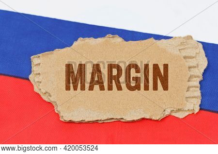 Business And Finance Concept. Against The Background Of The Russian Flag Lies Cardboard With The Ins