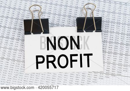 Business And Finance Concept. On The Table There Are Reports And A Business Card With The Inscriptio