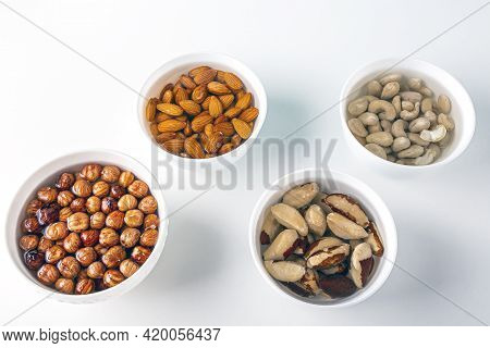 Process Of Soaking Various Nuts: Almonds, Hazelnuts, Cashew, Brazilian Nut In Water To Activate. Hom