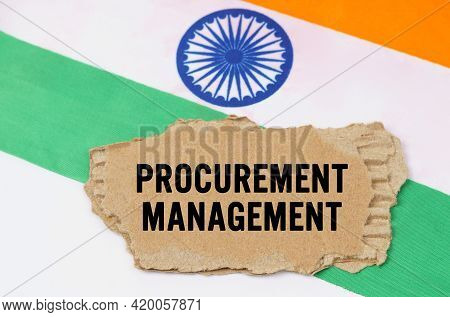 Business And Finance Concept. The Indian Flag Has A Cardboard Box With The Inscription- Procurement