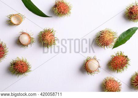 Ripe Rambutan Fruit Pattern On White, Flat Lay Background, Rambutan Is Tropical Fruit And Native Sou