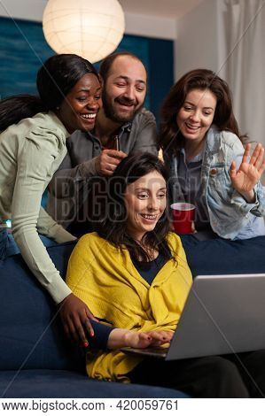 Multi Ethnic Friends Waving At Laptop Webcam During Video Call