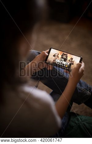 Illustrative Editorial Image Of Child Playing Call Of Duty Mobile
