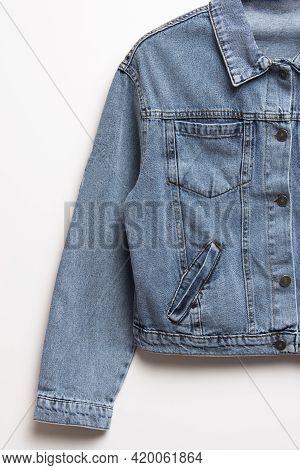 Blue Denim Jacket For Background. Close Up Of The Front Of A Denim Jacket. Close-up Denim Jacket Poc