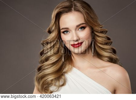 Hair Beauty Woman Portrait. Model Girl Luxury Hairstyle And Red Lips Make Up. Volume Curly Blonde Ha