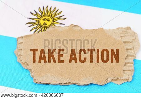 Business And Finance Concept. Against The Background Of The Flag Of Argentina Lies Cardboard With Th