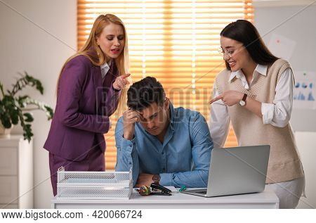 Coworkers Bullying Their Colleague At Workplace In Office