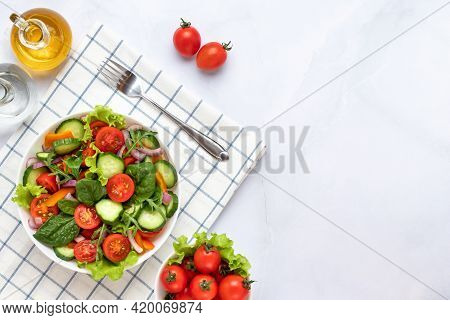 Vegetables On A White Plate On A Gray Marble Background. Top View. Salad Made With Cherry Tomatoes,