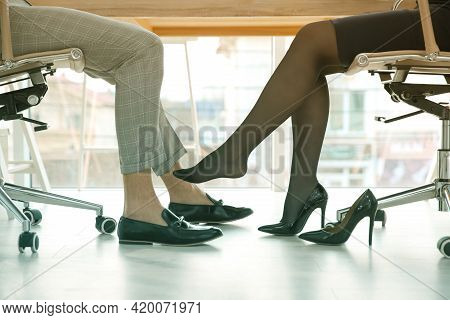 Woman Flirting With His Colleague During Work In Office, Closeup. Cheating Concept