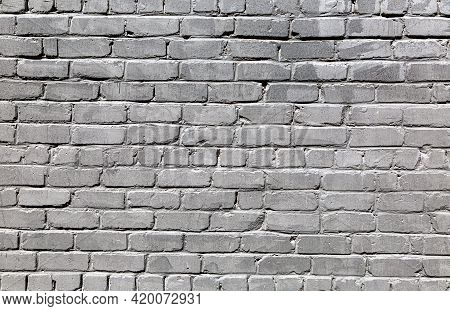 Black Weathered Red Brick Wall As Background Texture. Bricks Masonry With Uneven Seams