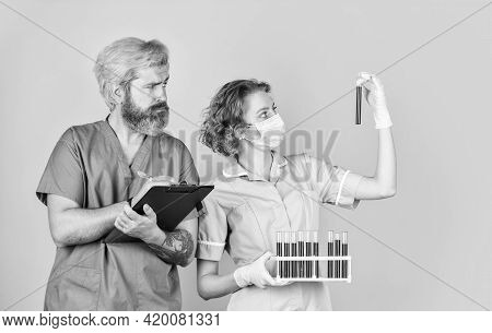Medical Couple Testing Tubes Vaccination. Blood Analysis. Good News. Blood Samples. Virus Remedy In