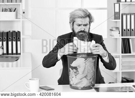 Interesting Info. Man In Office Look For Lost Note In Paper Bin. Crumpled Paper In Wastepaper Basket