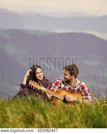 Love Song. Couple In Love Spend Free Time Together. Western Camping. Hiking Adventure. Happy Friends