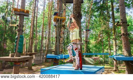 Girl Laughs In Adventure High-rope Park. Emotions Of Delight, Rapture, Joy And Surprise On The Girl'
