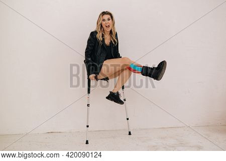 Young Beautiful Woman Broke Her Leg, Accident. Rehabilitation With Kineso Tapes And Leg Orthosis. He