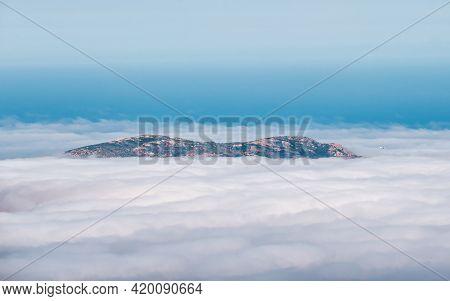 The Promontory Of La Revellata Near Calvi In The Balagne Region Of Corsica Appears Through A Veil Of